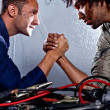Mechanics arm-wrestling — Stock Photo