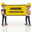 3D construction workers with a sign — Stock Photo