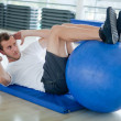 Gym mdoing abs — Stock Photo #7762285