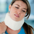 Woman with surgical collar - Stock Photo