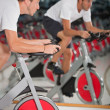 Foto Stock: Man doing spinning at the gym