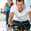 Doing spinning at the gym — 图库照片