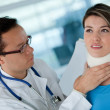 Injured woman with a doctor — Stock Photo