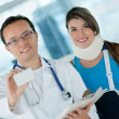 Stock Photo: Doctor with injured woman