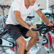 Stock Photo: Man doing spinning at the gym