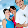 Gym women with their trainer — Stock Photo