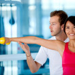Stock Photo: Gym woman with her trainer