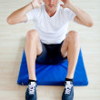 Gym man doing abs — Stock Photo #7764021