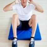 Gym man doing abs — Stock Photo