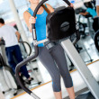 Girl exercising at the gym - Stock Photo