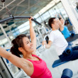 Woman exercising at the gym — Stock Photo #7764075