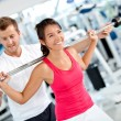 Gym woman with her trainer - Stock Photo