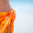 Stock Photo: Beach womwearing sarong