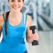 Gym woman with free-weights — Stock Photo #7764253