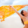 Stock Photo: Beach womfeeling wind