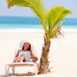 Beach woman under the shadow - Stock Photo