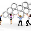 3D business team assembling gears - Stock Photo