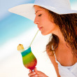 Woman drinking a refreshing beverage — Stock Photo