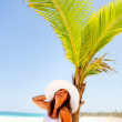 Woman under a palm-tree — Stock Photo