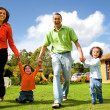 Happy family having fun outdoors — Foto Stock