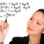 Asian girl solving a mathematical formula — Stock Photo