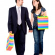 Couple walking with shopping bags — Stock Photo
