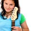Teenage girl with her electric guitar — Stock Photo