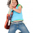 Girl playing an electric guitar — Stock Photo