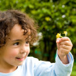 Child with a flower — Stock Photo #7765059