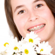 Beautiful girl with flowers - Stockfoto