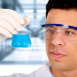 Scientist in a science laboratory - Stock Photo