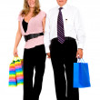 Couple with shopping bags walking — Stock Photo #7765080