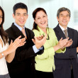 Business office team smiling and applauding - Stock Photo