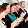 Group of business applauding — Stock Photo