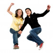 Happy couple jumping — Stock Photo