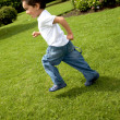 Child running outdoors — Stock Photo