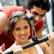 Gym woman and her trainer — Stock Photo