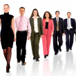 Foto Stock: Business team walking forward