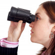 Business woman searching with binoculars - Stock Photo