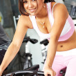 Stock Photo: Girl working out at gym