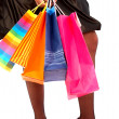 Stock Photo: Girl holding shopping bags