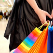 Royalty-Free Stock Photo: Hands holding shopping bags
