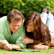 Couple reading outdoors — Stock Photo