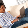 Man on a laptop at home — Stock Photo