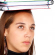 Student with books on her head — Stock Photo