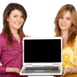 Girls displaying a laptop computer — Stock Photo