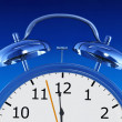 Blue alarm clock — Stockfoto