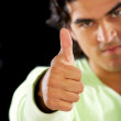 Casual man doing a thumbs up — Foto Stock