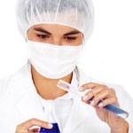 Female chemist using test tubes — Stock Photo