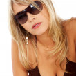 Blond sexy woman with sunglasses — Stock Photo